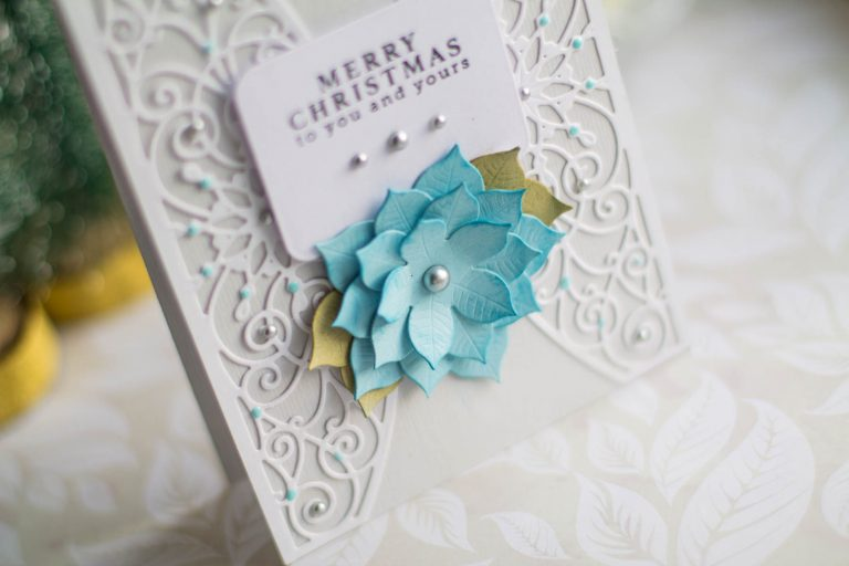 Spellbinders A Charming Christmas Collection by Becca Feeken - Inspiration | Merry Christmas Card with Elena Salo featuring S4-963 Snowflake Toppers, S5-379 Yuletide Snowflakes, S5-384 Charming Tag Pocket, S4-960 Cinch and Go Poinsettia #spellbinders #neverstopmaking #amazingpapergrace