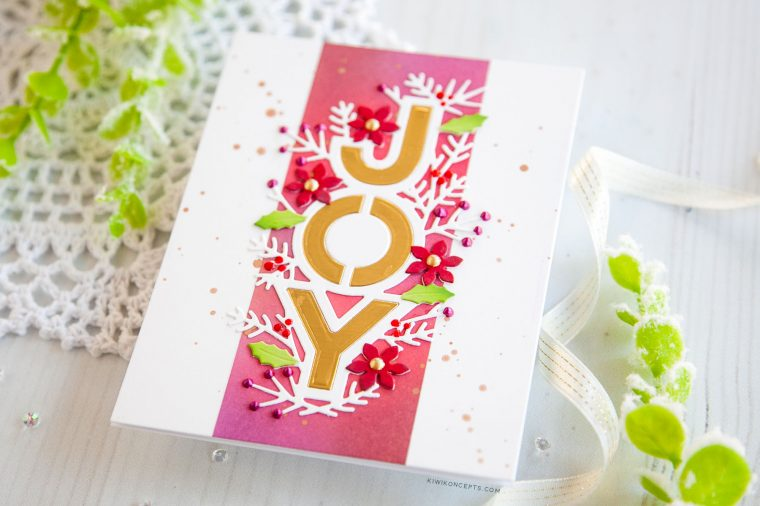 "Spellbinders Holiday 2019 Inspiration | Clean & Simple Christmas Cards with Keeway Tsao. Keeway says: ""My first card features the Joy Dies. This delicate die cuts out the world 'JOY' with a border decorated with several holiday floral and foliage shapes."""